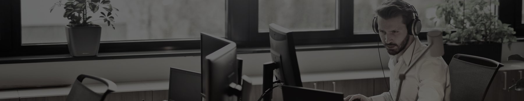 Man at a desk on the phone